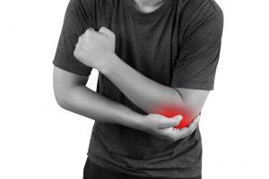 Entezopatia łokcia - ból po stronie bocznej - sportowiec